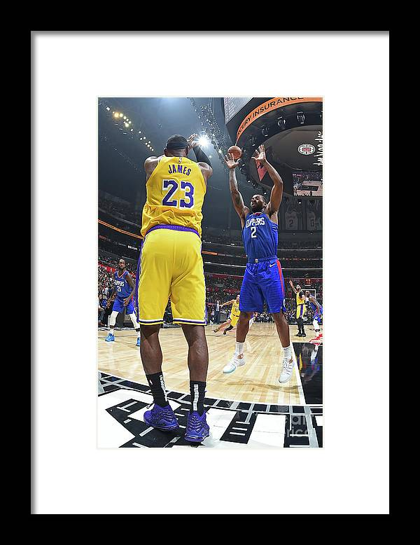 Nba Pro Basketball Framed Print featuring the photograph Kawhi Leonard and Lebron James by Andrew D. Bernstein