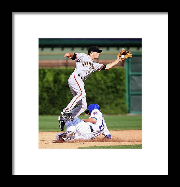 People Framed Print featuring the photograph Kelby Tomlinson and Kris Bryant by Jonathan Daniel