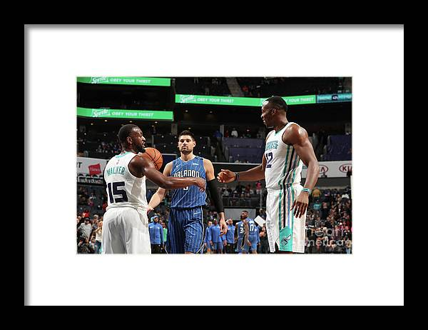 Kemba Walker Framed Print featuring the photograph Kemba Walker and Dwight Howard by Kent Smith