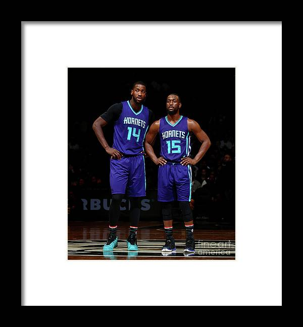 Kemba Walker Framed Print featuring the photograph Kemba Walker and Michael Kidd-gilchrist by Nathaniel S. Butler