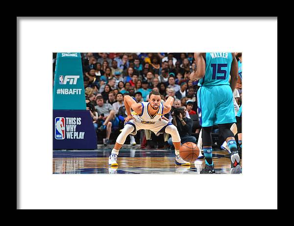 Kemba Walker Framed Print featuring the photograph Kemba Walker and Stephen Curry by Jesse D. Garrabrant