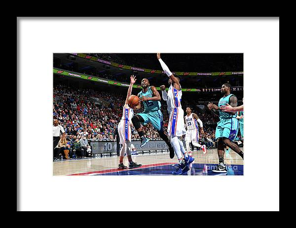 Kemba Walker Framed Print featuring the photograph Kemba Walker by Jesse D. Garrabrant