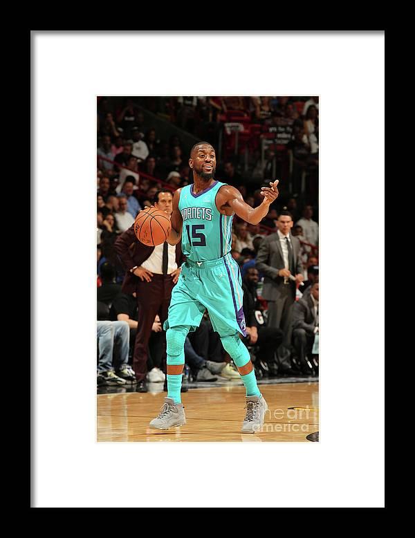 Kemba Walker Framed Print featuring the photograph Kemba Walker by Oscar Baldizon