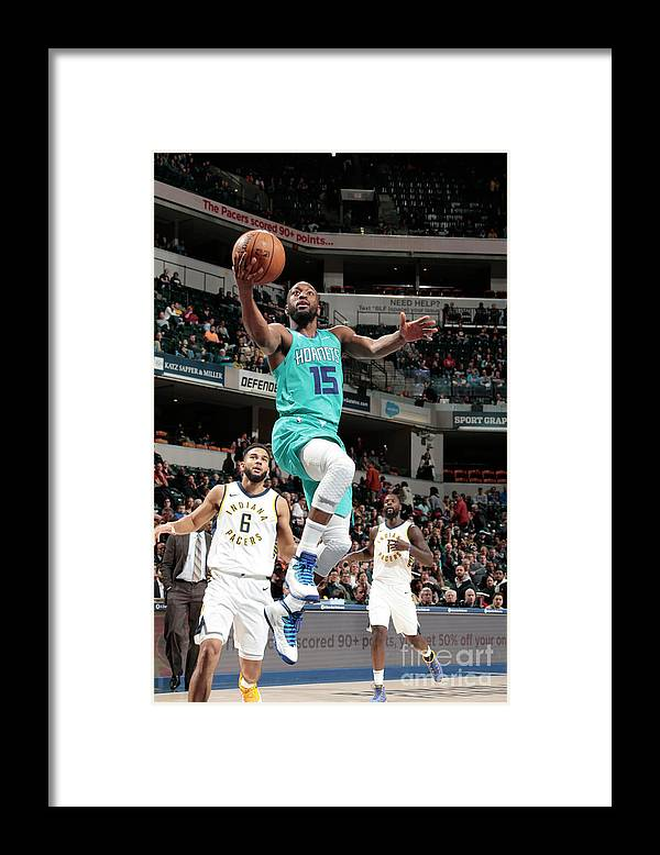 Kemba Walker Framed Print featuring the photograph Kemba Walker by Ron Hoskins