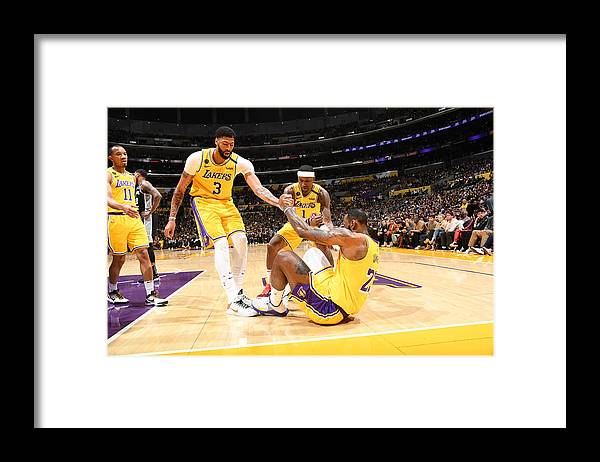 Nba Pro Basketball Framed Print featuring the photograph Kentavious Caldwell-pope, Anthony Davis, and Lebron James by Andrew D. Bernstein