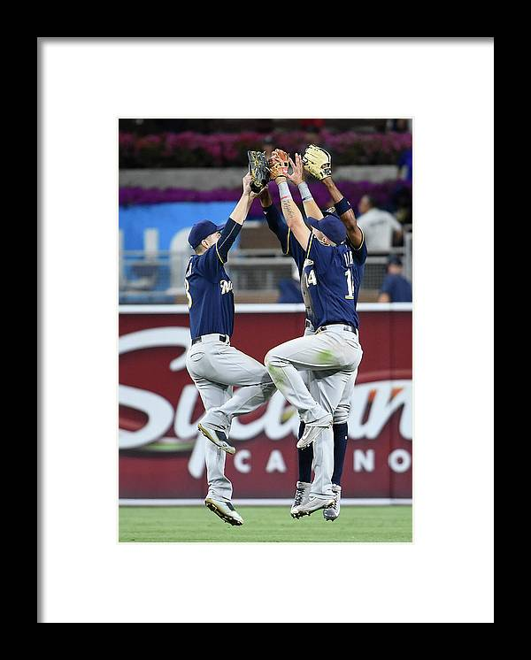 People Framed Print featuring the photograph Keon Broxton and Ryan Braun by Denis Poroy