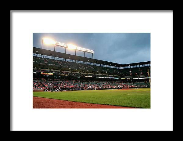 American League Baseball Framed Print featuring the photograph Kevin Gausman and Melky Cabrera by Rob Carr