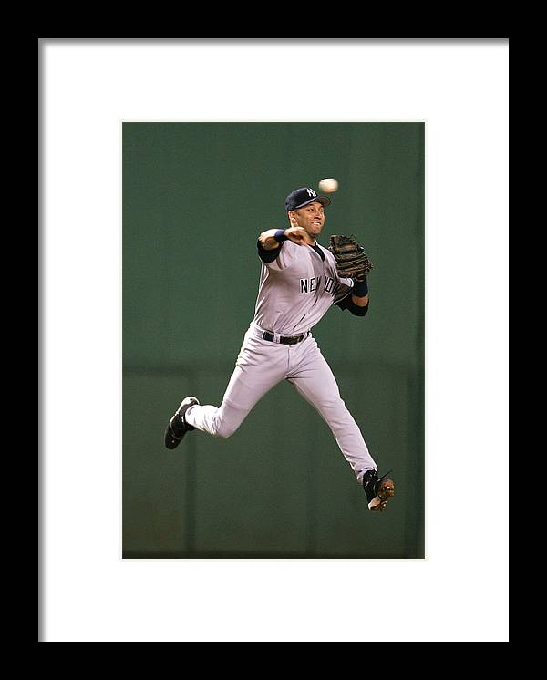 People Framed Print featuring the photograph Kevin Millar and Derek Jeter by Al Bello