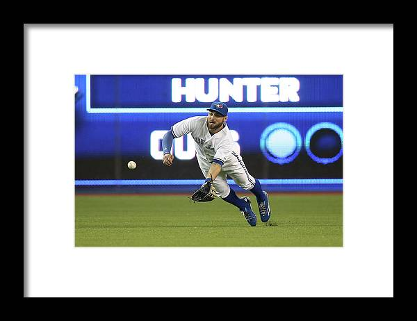 Ninth Inning Framed Print featuring the photograph Kevin Pillar and Dee Gordon by Tom Szczerbowski