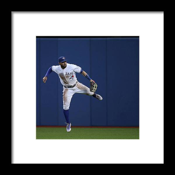 People Framed Print featuring the photograph Kevin Pillar and Jonathan Schoop by Tom Szczerbowski