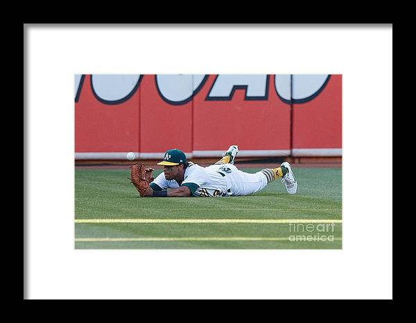 People Framed Print featuring the photograph Khris Davis And George Springer by Jason O. Watson