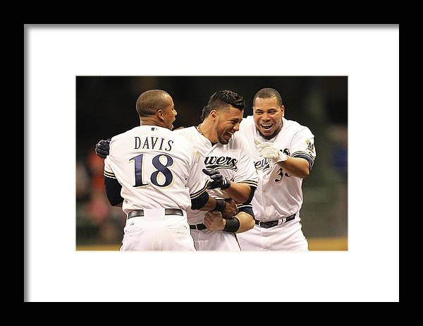 Celebration Framed Print featuring the photograph Khris Davis, Wily Peralta, and Yovani Gallardo by Mike Mcginnis