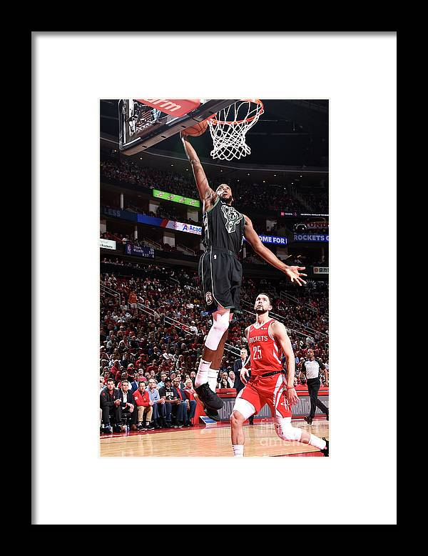 Nba Pro Basketball Framed Print featuring the photograph Khris Middleton by Bill Baptist