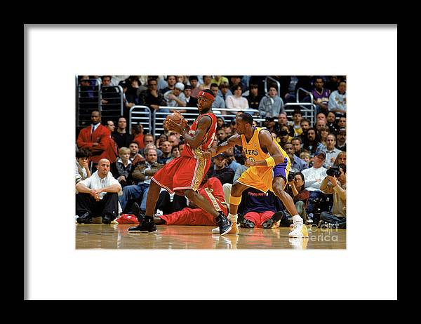 Nba Pro Basketball Framed Print featuring the photograph Kobe Bryant and Lebron James by Andrew D. Bernstein