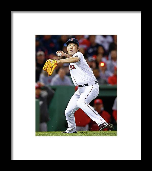 American League Baseball Framed Print featuring the photograph Koji Uehara by Jared Wickerham