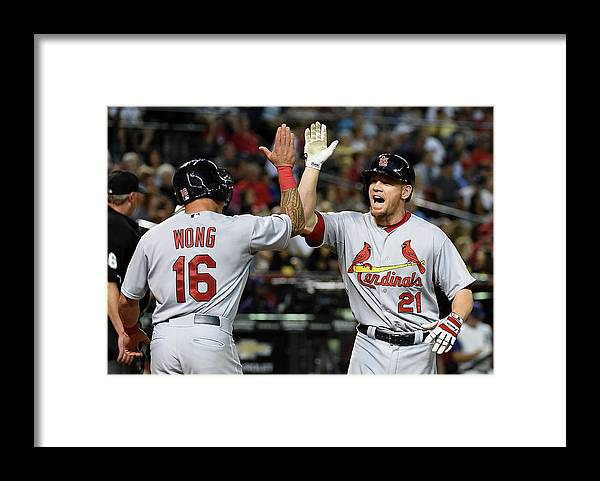 St. Louis Cardinals Framed Print featuring the photograph Kolten Wong and Brandon Moss by Norm Hall