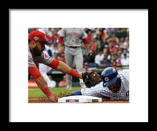 People Framed Print featuring the photograph Kris Bryant and Eugenio Suarez by David Banks