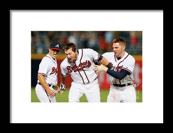 Atlanta Framed Print featuring the photograph Kris Medlen, Freddie Freeman, and Chris Johnson by Kevin C. Cox