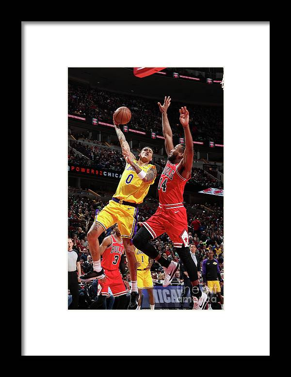 Nba Pro Basketball Framed Print featuring the photograph Kyle Kuzma by Nathaniel S. Butler