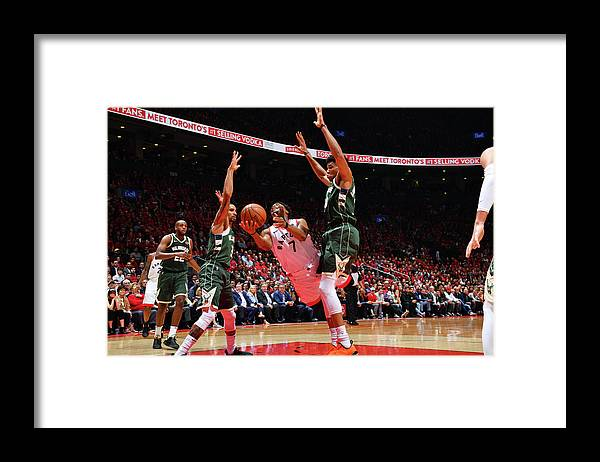 Playoffs Framed Print featuring the photograph Kyle Lowry and Giannis Antetokounmpo by Jesse D. Garrabrant