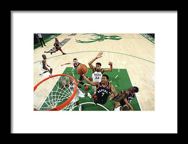 Playoffs Framed Print featuring the photograph Kyle Lowry and Giannis Antetokounmpo by Nathaniel S. Butler