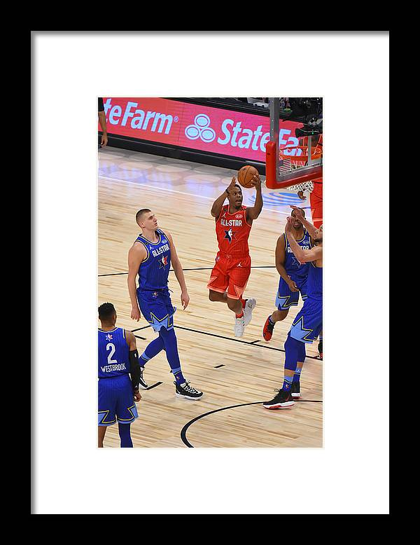 Nba Pro Basketball Framed Print featuring the photograph Kyle Lowry by Bill Baptist