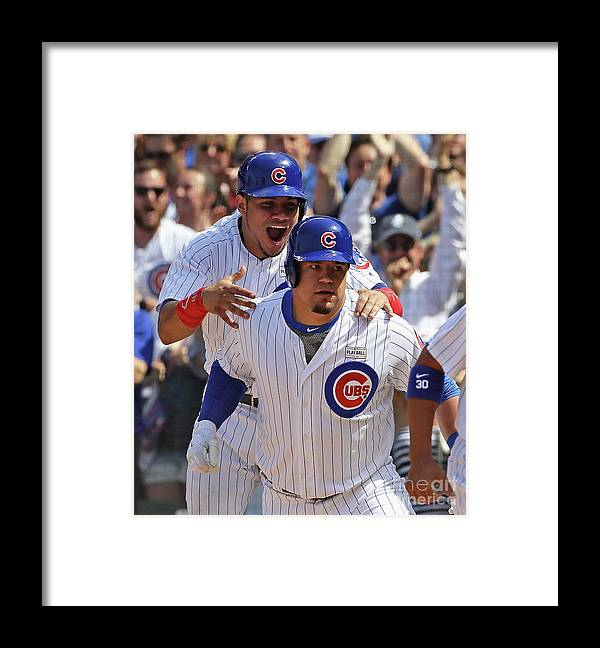 Three Quarter Length Framed Print featuring the photograph Kyle Schwarber and Willson Contreras by Jonathan Daniel