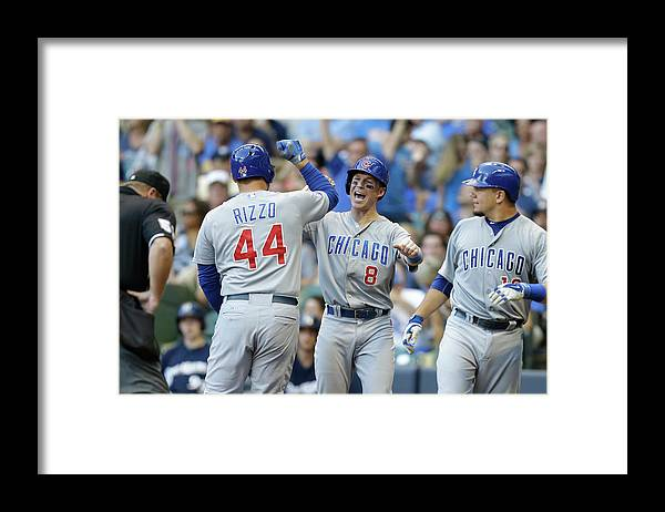 Three Quarter Length Framed Print featuring the photograph Kyle Schwarber, Anthony Rizzo, and Chris Coghlan by Mike Mcginnis