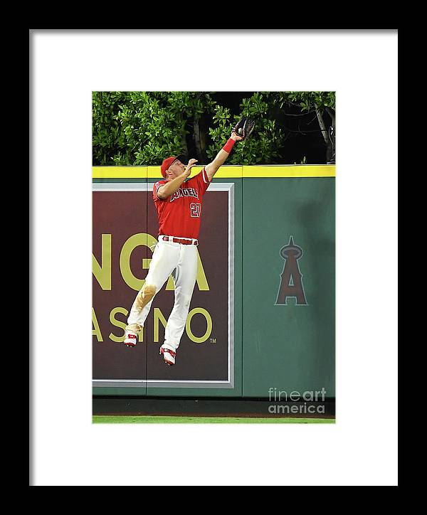 People Framed Print featuring the photograph Kyle Seager And Mike Trout by Jayne Kamin-oncea
