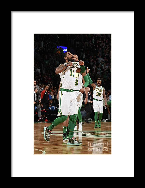 Nba Pro Basketball Framed Print featuring the photograph Kyrie Irving and Marcus Morris by Brian Babineau