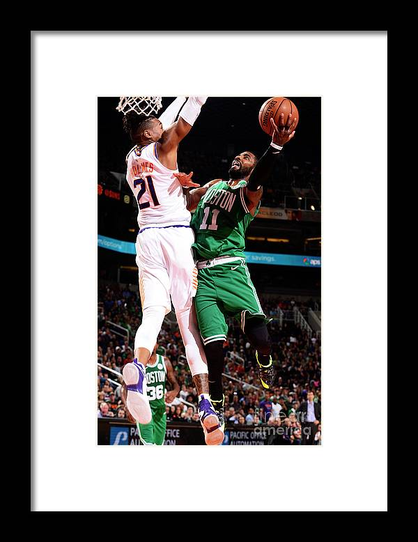 Nba Pro Basketball Framed Print featuring the photograph Kyrie Irving and Richaun Holmes by Barry Gossage