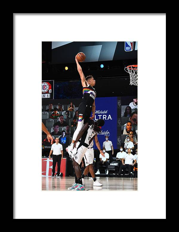 Nba Pro Basketball Framed Print featuring the photograph LA Clippers v Denver Nuggets - Game Three by Garrett Ellwood