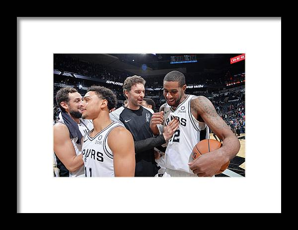 Following Framed Print featuring the photograph Lamarcus Aldridge and Pau Gasol by Mark Sobhani
