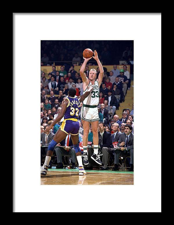 1980-1989 Framed Print featuring the photograph Larry Bird and Magic Johnson by Andrew D. Bernstein