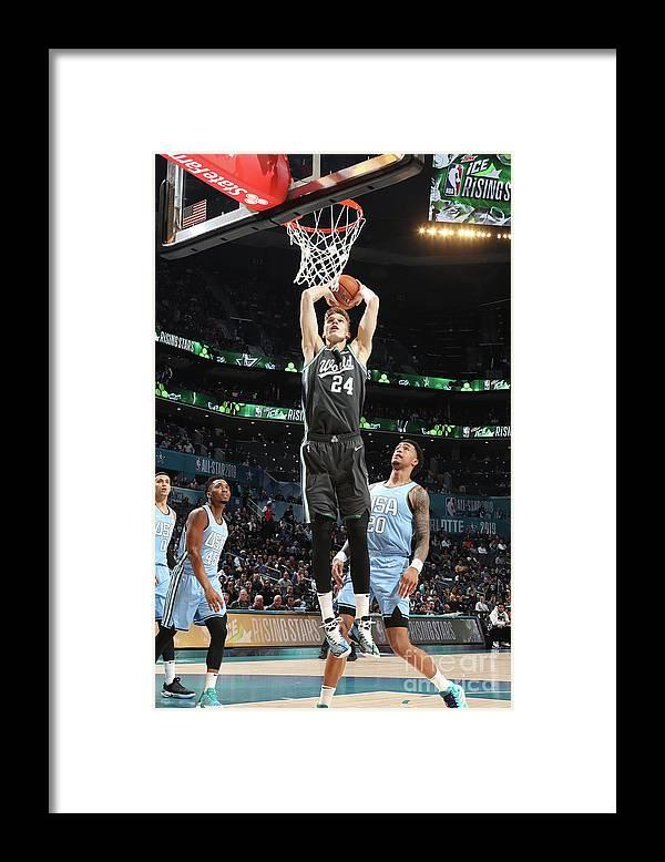 Nba Pro Basketball Framed Print featuring the photograph Lauri Markkanen by Nathaniel S. Butler
