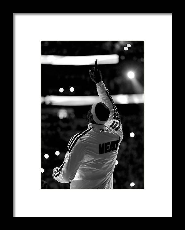 Lebron James Framed Print featuring the photograph Lebron James by Mike Ehrmann