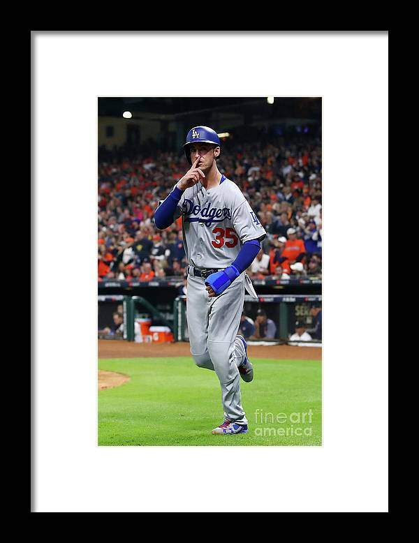 People Framed Print featuring the photograph Logan Forsythe and Cody Bellinger by Ezra Shaw