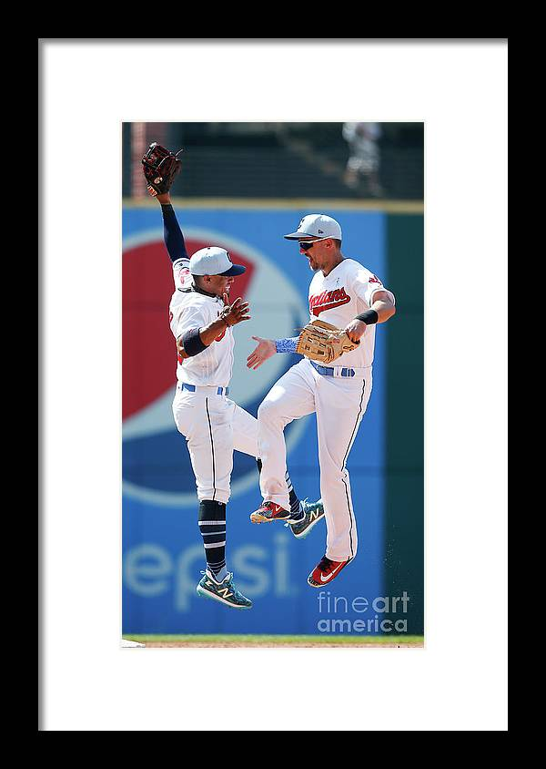 People Framed Print featuring the photograph Lonnie Chisenhall and Francisco Lindor by Ron Schwane