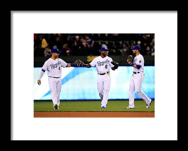 People Framed Print featuring the photograph Lorenzo Cain, Alex Gordon, and Paulo Orlando by Jamie Squire