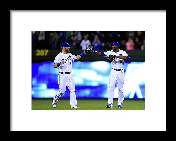 American League Baseball Framed Print featuring the photograph Lorenzo Cain and Alex Gordon by Jamie Squire