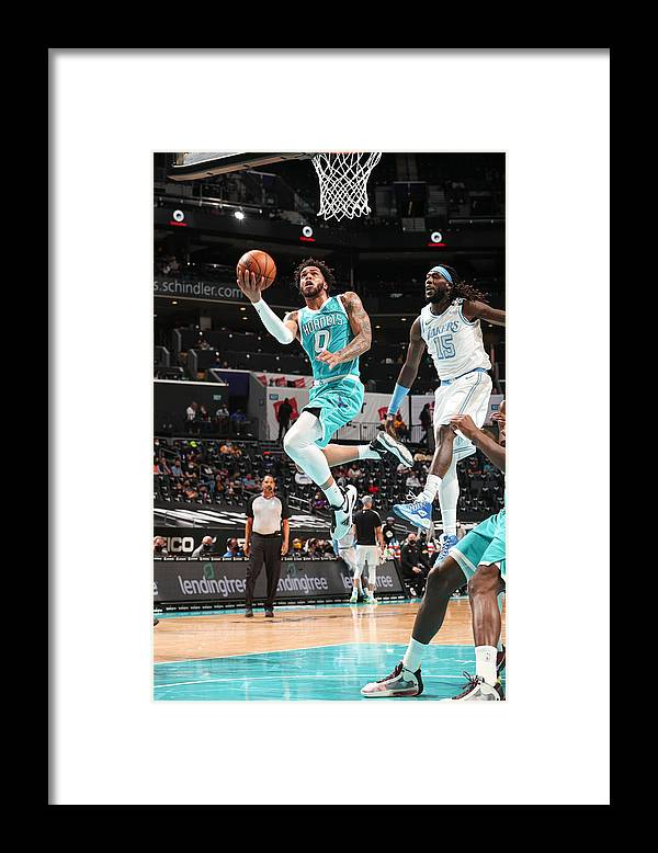 Nba Pro Basketball Framed Print featuring the photograph Los Angeles Lakers v Charlotte Hornets by Kent Smith
