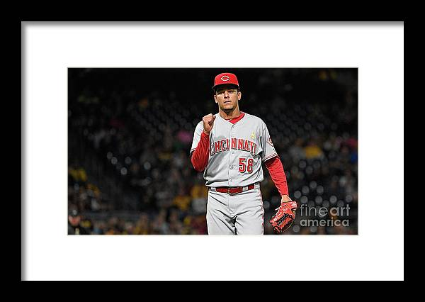 Three Quarter Length Framed Print featuring the photograph Luis Castillo and Chris Stewart by Justin Berl