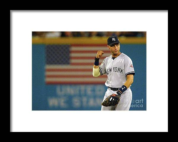 Fist Framed Print featuring the photograph Luis Castillo and Derek Jeter by Jed Jacobsohn