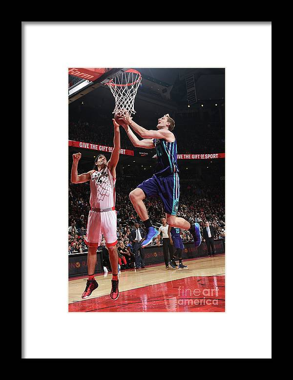 Nba Pro Basketball Framed Print featuring the photograph Luis Scola and Cody Zeller by Ron Turenne