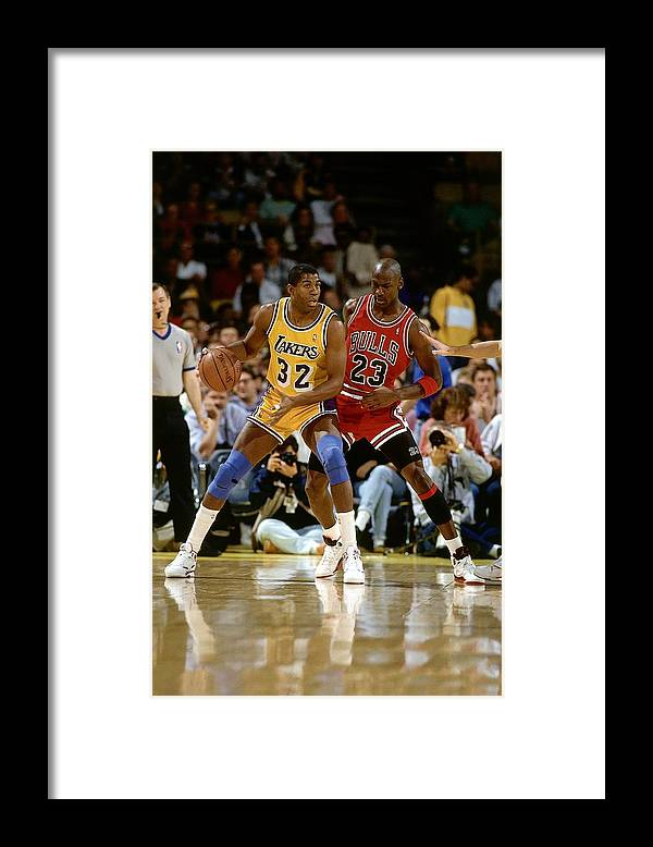 Chicago Bulls Framed Print featuring the photograph Magic Johnson and Michael Jordan by Andrew D. Bernstein