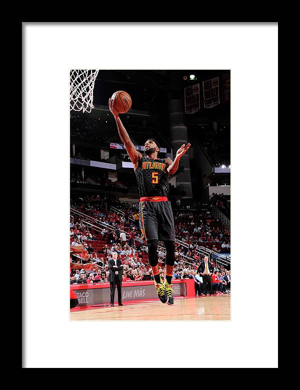 Nba Pro Basketball Framed Print featuring the photograph Malcolm Delaney by Bill Baptist