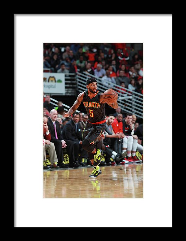 Nba Pro Basketball Framed Print featuring the photograph Malcolm Delaney by Jeff Haynes