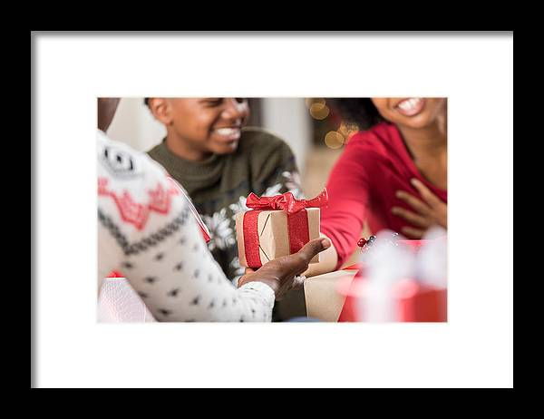 Child Framed Print featuring the photograph Man Gives Adult Daughter A Gift At Christmas by SDI Productions