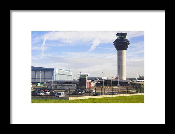 Tranquility Framed Print featuring the photograph Manchester airport. by Mark Williamson