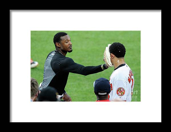 People Framed Print featuring the photograph Manny Machado and Adam Jones by Greg Fiume